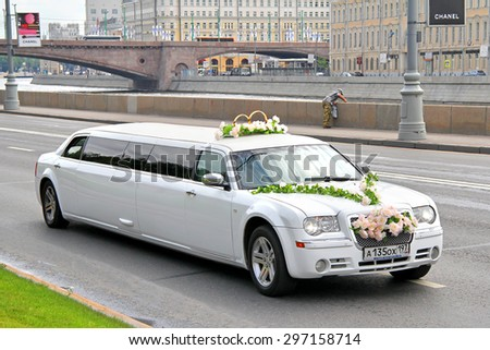 MOSCOW, RUSSIA - JULY 7, 2012: White limousine Chrysler 300C at the city street. - stock photo