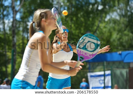 MOSCOW, RUSSIA - JULY 20, 2014: Woman double of Latvia in the match against Bulgaria during ITF Beach Tennis World Team Championship. Bulgaria won in two sets - stock photo