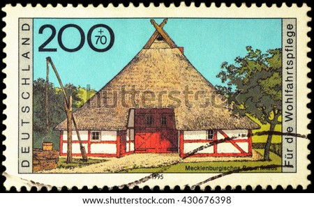 "MOSCOW, RUSSIA - JUNE 02, 2016: A stamp printed in Germany shows Mecklenburgisches farmhouse, series ""Charity Stamps - Farmhouses"", circa 1995"