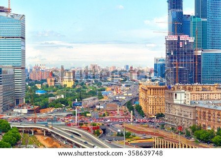 MOSCOW, RUSSIA - JUNE 9, 2014: active urban life, cars on the roads, the business center Moscow City - stock photo