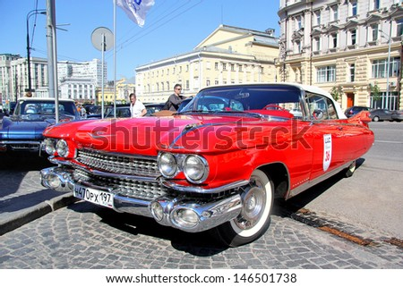 MOSCOW, RUSSIA - JUNE 2: American motor car Chevrolet Corvette competes at the annual L.U.C. Chopard Classic Weekend Rally on June 2, 2013 in Moscow, Russia. - stock photo