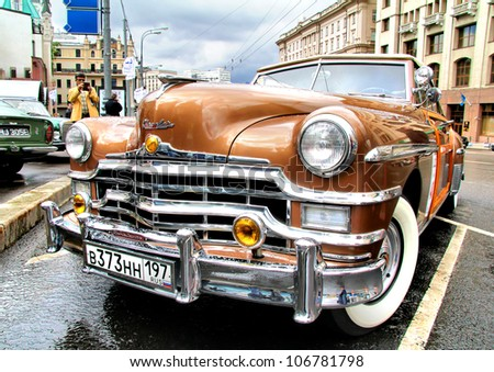 MOSCOW, RUSSIA - JUNE 3: American motor car Chrysler Town & Country competes at the annual L.U.C. Chopard Classic Weekend Rally on June 3, 2012 in Moscow, Russia. - stock photo