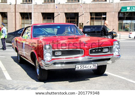 MOSCOW, RUSSIA - JUNE 2, 2013: American motor car Pontiac GTO competes at the annual L.U.C. Chopard Classic Weekend Rally. - stock photo