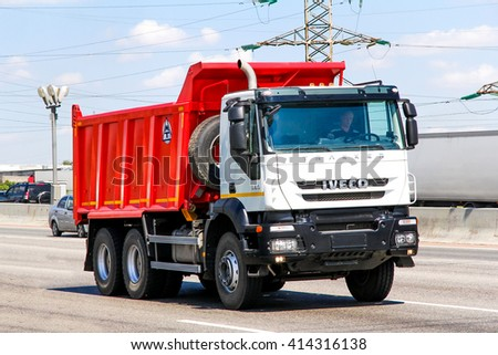 MOSCOW, RUSSIA - JUNE 2, 2012: Brand new dump truck Iveco Trakker at the interurban freeway. - stock photo