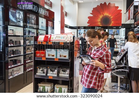 MOSCOW, RUSSIA - June 26, 2012 - Cosmetics store at large shopping mall - stock photo