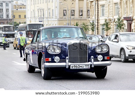 MOSCOW, RUSSIA - JUNE 2, 2013: English motor car Bentley S3 Continental competes at the annual L.U.C. Chopard Classic Weekend Rally. - stock photo