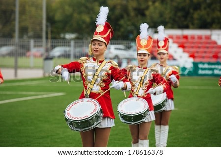 Moscow, Russia - June 11: Girls drummer orchestra plays at a football match during a break. June 11, 2013 in Moscow, Russia - stock photo