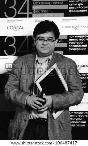 "MOSCOW, RUSSIA - JUNE 30: Movie director Andrey Proshkin with award for his movie ""The Horde"" at XXXIV Moscow International Film Festival  Taken on June 30, 2012 in Moscow, Russia."