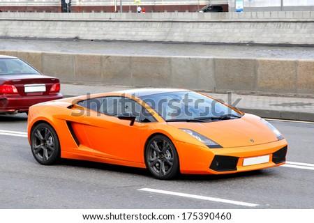 MOSCOW, RUSSIA - JUNE 2, 2013: Orange Lamborghini Gallardo sportscar at the city street. - stock photo