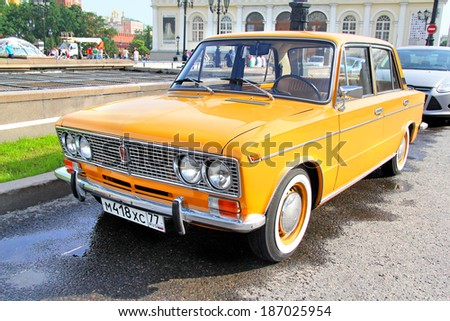 MOSCOW, RUSSIA - JUNE 2, 2013: Orange VAZ 2103 Zhiguli classic soviet vehicle at the city street. - stock photo