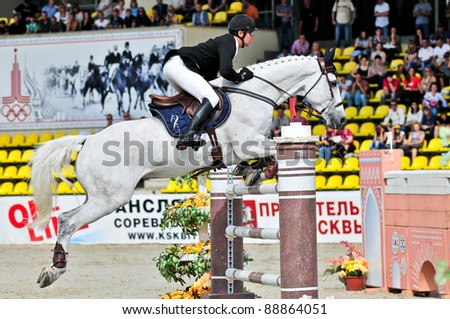 MOSCOW, RUSSIA - JUNE 26: rider Varna Andis(LAT) at the latvian horse Marmors in stage of the International event CSI4*RR/ Russian Championship Show Jumping on June 26, 2011 in Moscow, Russia