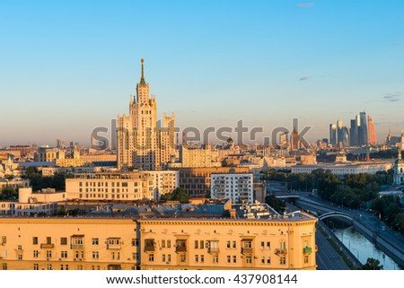 """MOSCOW, RUSSIA - JUNE 13, 2016: Stunning view of Garden Ring, Stalin's high-rise building on kotelnicheskaya embankment and business complex """"Moscow City"""" in the summer during dawn - stock photo"""