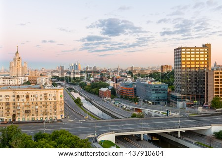"""MOSCOW, RUSSIA - JUNE 13, 2016: Stunning view of Garden Ring, Stalin's high-rise building on kotelnicheskaya embankment, business complex """"Moscow City"""" in the summer during dawn - stock photo"""
