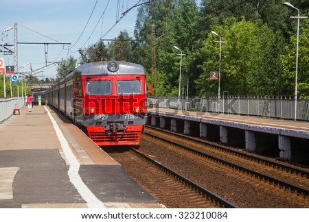 Moscow, Russia - June 2, 2015: The electric train arrives at the platform conductor. Trains in the four directions of railways suburbs will run every seven minutes - stock photo