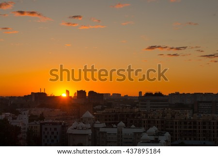 MOSCOW, RUSSIA - JUNE 13, 2016: The rays of the rising sun over the city - stock photo