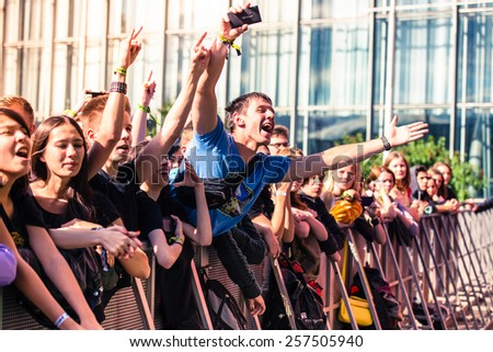 MOSCOW, RUSSIA - JUNE 29, 2014 - Visitors at Park Live festival at at the National Exhibition Centre on June 29, 2014 in Moscow, Russia - stock photo
