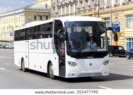 MOSCOW, RUSSIA - JUNE 2, 2013: White intercity coach bus Lahti Scania OmniExpress 360 in the city street. - stock photo