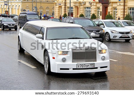 MOSCOW, RUSSIA - JUNE 3, 2012: White limousine Chrysler 300C at the city street. - stock photo