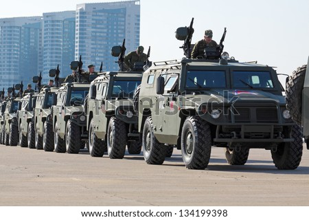 MOSCOW, RUSSIA, KHODYNKA, - APR 26: military vehicles are going to pass on Red Square. The rehearsal is to celebrate the upcoming 66th Anniversary of Victory Day on April, 26, 2011 in Moscow, Russia - stock photo