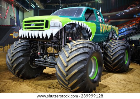 MOSCOW, RUSSIA - MAR 29, 2014: Green car with huge wheels, participant show Monster X Tour in Moscow - stock photo