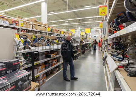 MOSCOW, RUSSIA - MARCH 03, 2015. A man makes a purchase of Leroy Merlin Store. Leroy Merlin is a French home-improvement and gardening retailer serving thirteen countries - stock photo