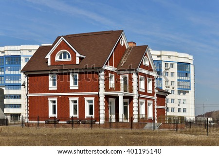 MOSCOW, RUSSIA - MARCH 29, 2016: Construction of new apartment houses in Moscow. Low-rise houses on banks of Moscow River - stock photo