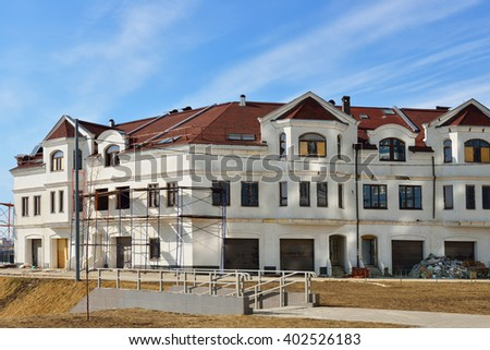 MOSCOW, RUSSIA - MARCH 29, 2016: Construction of new apartment houses in Moscow. Under construction townhouses