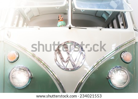Moscow, Russia - March 3, 2013: Front view of a green and white 1960s VW campervan with the iconic volkswagen badge and double windshield.