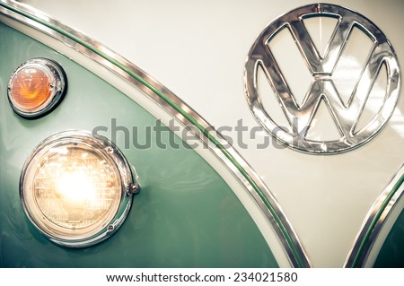 Moscow, Russia - March 3, 2013: Front view of a green and white 1960s VW campervan with the iconic volkswagen badge.