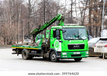 MOSCOW, RUSSIA - MARCH 8, 2015: Green rescue service truck MAN TGL in the city street. - stock photo