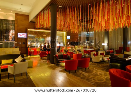 MOSCOW, RUSSIA - MARCH 29, 2015: Hilton hotel interior. Hilton Hotels & Resorts is an international chain of full service hotels and resorts and the flagship brand of Hilton Worldwide - stock photo