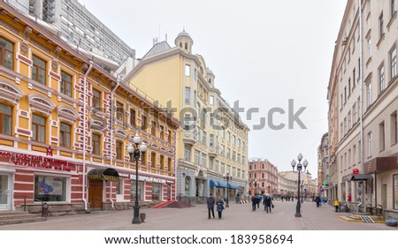 MOSCOW, RUSSIA - MARCH 17 2014: Locals and tourists walking on Arbat street, famous touristic landmark in Moscow with lot of shops and traditional buildings