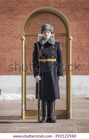 MOSCOW/RUSSIA - 01 March 2016: Military student stands and sleep in sentry box in guard in honor of grave of the Unknown Soldier and The Eternal Flame on 01 March 2016 in Moscow. - stock photo