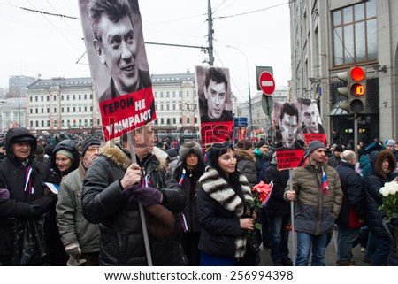 Moscow, Russia - March 1, 2015. Nemtsov's portraits on mourning march of memory. March to the memory of Boris Nemtsov, Russian opposition leader who was assassinated on the eve of