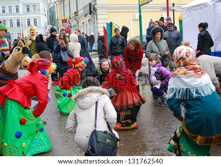 MOSCOW, RUSSIA - MARCH 16: People dancing folk dances on the street. Shrovetide celebration in Moscow city center. Taken on March 16, 2013 in Moscow, Russia.