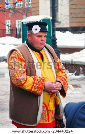 MOSCOW, RUSSIA - MARCH 16: Portrait of a man in national costume. Shrovetide celebration in Moscow city center. Taken on March 16, 2013 in Moscow, Russia.  - stock photo