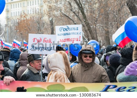 "MOSCOW, RUSSIA - MARCH 2: Russian demonstrators holding posters with text ""Good bye America"" and ""Motherland starts with Mother"" on rally in support of U.S. adoption ban. Moscow, March 2, 2013"