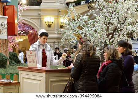 MOSCOW, RUSSIA - MARCH 20, 2016: Saleswoman of ice cream and buyers at State Department Store (GUM) - stock photo