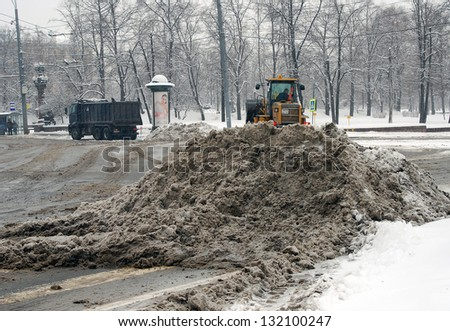 MOSCOW, RUSSIA - MARCH 15: Special machines clearing streets from snow. Extreme snowstorm in Moscow. Taken on March 15, 2013 in Moscow, Russia.