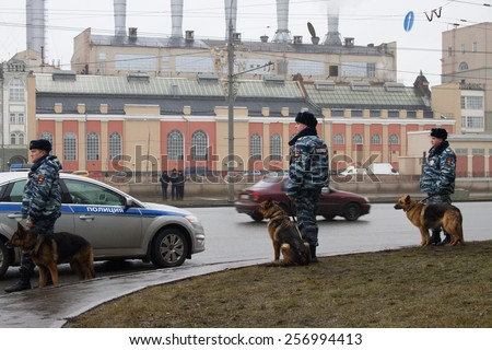 Moscow, Russia - March 1, 2015. The Russian police and dogs on oppositional march. March to the memory of Boris Nemtsov, Russian opposition leader who was assassinated on the eve of