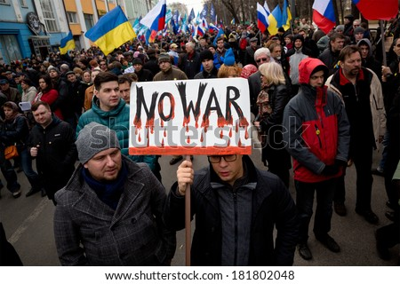 MOSCOW, RUSSIA - MARCH 15: Thousands people marched against war in Ukraine in center of Moscow, March 15, 2014, Russia  - stock photo