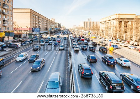 MOSCOW, RUSSIA - MARCH 27, 2015: urban transport on Leningradskoye shosse in spring day. Leningradskoye Highway is a part of M10 federal highway Moscow to Saint Petersburg inside Moscow - stock photo
