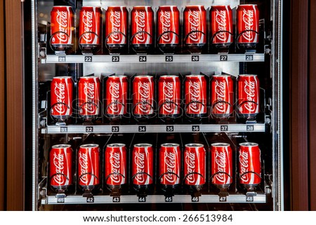 MOSCOW, RUSSIA - MARCH 15: Vending machine full of coca-cola cans in Moscow, Russia on March 13, 2015. Coca-Cola sold in stores, restaurants, and vending machines throughout the world. - stock photo