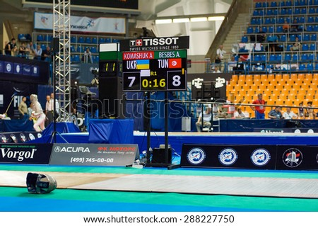 MOSCOW, RUSSIA - MAY 31 2015: A. Komashuk and A. Besbes score board on the World  fencing Grand Prix Moscow Saber in Luzhniki sport palace - stock photo