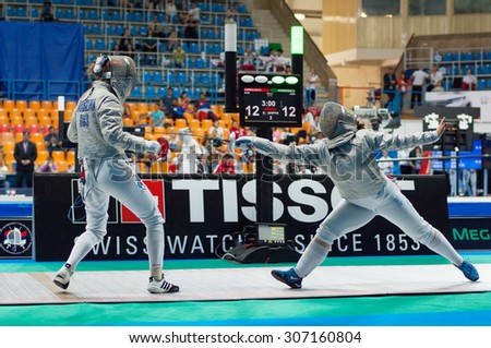 MOSCOW, RUSSIA - MAY 31 2015: A. Komashuk versus E. Karbolina on the World  fencing Grand Prix Moscow Saber in Luzhniki sport palace - stock photo
