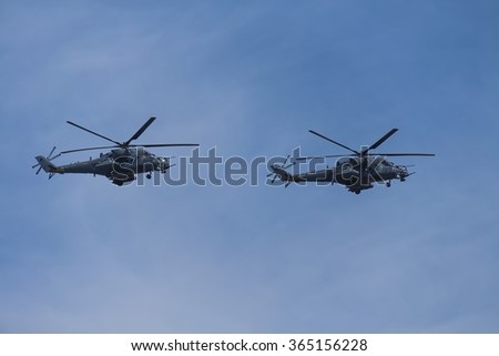MOSCOW, RUSSIA - MAY 9, 2015: A pairs of russian military helicopters Mi-24 in flight. Parade dedicated to May 9, 70-th Victory Day in World War II, Moscow, Russia.