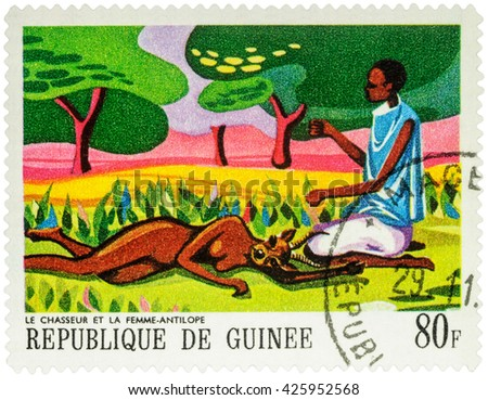 """MOSCOW, RUSSIA - MAY 12, 2016: A stamp printed in Guinea shows black man and antelope woman, series """"Paintings of African Legends"""", circa 1968 - stock photo"""