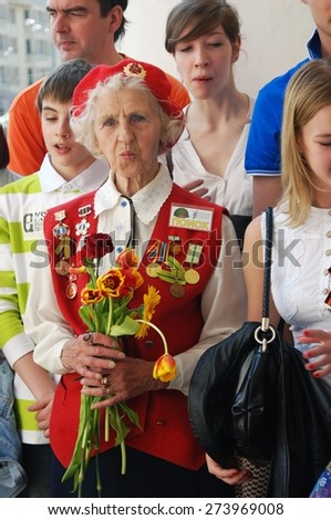 MOSCOW, RUSSIA - MAY 09: A war veteran holding flowers. Victory Day celebration on May 09, 2013 in Moscow.