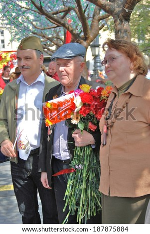 MOSCOW, RUSSIA - MAY 09, 2013: A war veteran holds flowers. Victory Day celebration in Moscow.