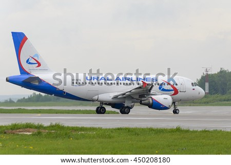 MOSCOW, RUSSIA - MAY 19, 2016: Airbus A319 Ural Airlines taxiing. Plane makes taxiing on taxiway Domodedovo International Airport. - stock photo